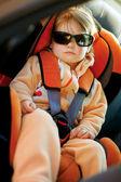Baby girl slip in car — Stock Photo
