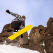 Snowboarder jumping — Stock Photo