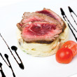 Stock Photo: Meat medium rare on mashed potatoes