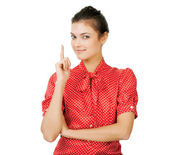 Attractive young woman with her finger up — Stock Photo