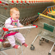 Beautiful baby in shopping cart - trolley — Stock Photo