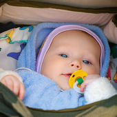 Smiling baby girl in a wheelchair — Stock Photo