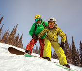 Happy snowboarding  couple  — Stock Photo