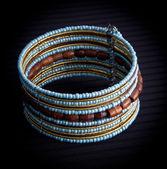 Blue beaded bracelet — Stock Photo