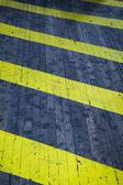 Sfondo e la consistenza del pericolo giallo e nero — Foto Stock
