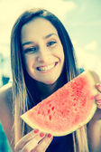 Portrait of a young woman smiling with water melon — Stock Photo