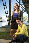 Portrait of a young couple smiling outside — Stock Photo