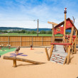 Big colorful children playground equipment - Stock Photo