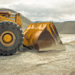 Buldozer at quarry - Stock Photo