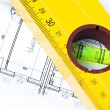 Spirit level and architectural drawings — Stock Photo #14005203