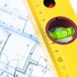 Spirit level and architectural drawings — Stock Photo #14005246