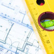 Spirit level and architectural drawings — Stock Photo #14005257
