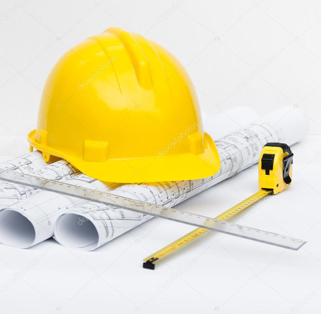 Rolls of architectural projects and construction tools stock photo