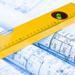 Spirit level and architectural drawings — Stock Photo #14168230