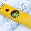 Spirit level and architectural drawings — Stock Photo #14168542