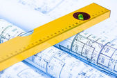 Spirit level and architectural drawings — Stok fotoğraf
