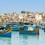 Traditional fishing boats of Malta in the fishing village of Marsaxlokk — Stock Photo #15898223