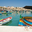 Traditional fishing boats of Malta in the fishing village of Marsaxlokk — Foto Stock