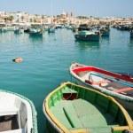 Traditional fishing boats of Malta in the fishing village of Marsaxlokk — Stock Photo #15900933