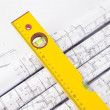 Construction level and blueprints — Stock Photo #38354383