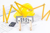 Construction tools with metric folding ruler and architectural drawings of the modern house — Stock Photo