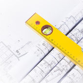 Construction level and blueprints — Stock Photo