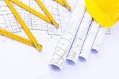 Rolls of architectural plans and construction tools — Stock Photo