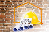 Gebouw bouwconcept met bakstenen achtergrond — Stockfoto