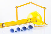 Architect rolls and construction tools — Stock Photo