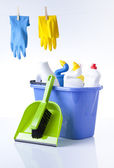 Cleaning detergents in bucket and gloves — Stock Photo