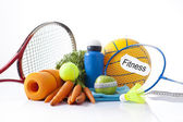 Healthy food and sport equipment isolated on white — Stock Photo