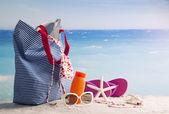 Beach bag with beach accessories — Stock Photo