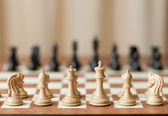 Chessboard with luxury chess pieces — Stock Photo