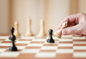 Moving chess pieces on chessboard — Stock Photo