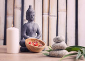 Wellness and spa concept with buddha figure — Stock Photo