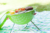 Summer garden party with grilled food — Stock Photo