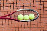 Tennis racket and tennis ball, sports equipment — Stock Photo