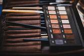 Makeup brush and cosmetics — Stock Photo