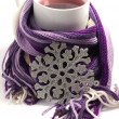 Hot tea wrapped in the scarf — Stock Photo
