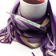 Hot fruit tea wrapped in the scarf — Stock Photo