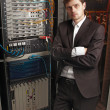 Senior Network engineer in server room - Stok fotoğraf