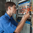 Stock Photo: Senior Network engineer in server room