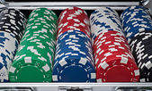 Complete set of gaming chips in silver suitcase — Stock Photo