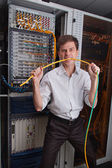 Network engineer in server room — Stock Photo
