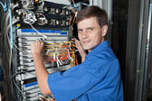 Senior Network engineer in server room — Stock Photo