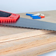 Hacksaw on plywood boards with dowels — Foto Stock