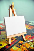 Blank canvas on easel — Stock Photo