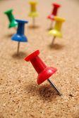 Thumbtacks on cork board — Stock Photo