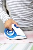 Man ironing — Stock Photo