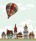 Set of cartoon houses and air balloon. — Stock Vector
